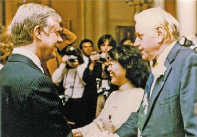US President Jimmy Carter greets novelist Hualing Nieh and her husband, Paul Engle, a fellow writer, at a White House reception in 1982. Provided to China Daily