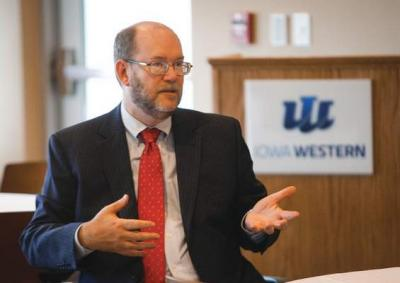 Dan Reed, University of Iowa's vice president for research and economic development, discusses entrepreneurship Thursday during a round-table discussion at Iowa Western Community College.