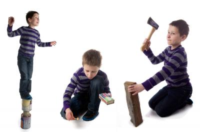 A young boy does dangerous things: play with matches, climbs unsteady objects and chops wood