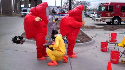 HazMat team members begin the decontamination process following a preparedness drill held on April 23 at Davenport's Modern Woodmen Park. Members of the Hygienic Laboratory's Emergency Preparedness team participated in the exercise to maintain readine