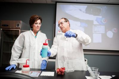 Demonstrating science experiments with Lt. Gov. Kim Reynolds