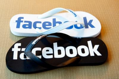 Flip flops with the the word Facebook in blue and white