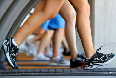 Close-up color image of legs on treadmill.