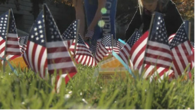 A close up of U.S. flags on the UI Pentacrest