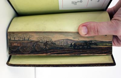 book with painting on the page edges