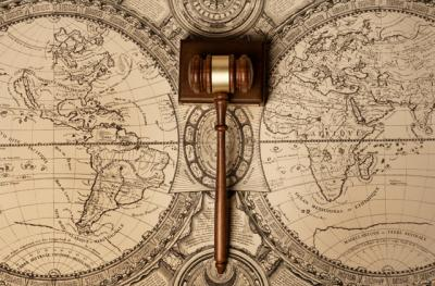 gavel on a world map