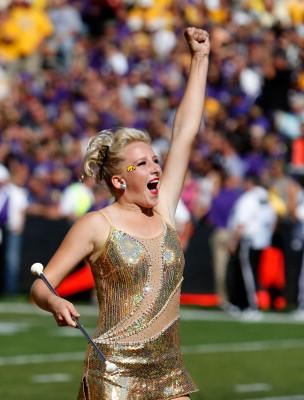 UI's Golden Girl performs at a game with baton in hand