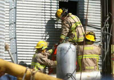 Waverly Fire Rescue respond to a call involving two men trapped in a grain bin at Scheider's Milling Inc. in Waverly, Iowa Thursday, Mar. 14, 2013. (TIFFANY RUSHING / Courier Staff Photographer)