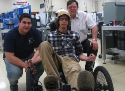 Western Iowa Tech Community College students Juan Verdin and Nathan Schulz are joined by mechanical engineering technology instructor Tom Helzer, right, on the recumbent trike that won the best technology award in a competition held at the University of I