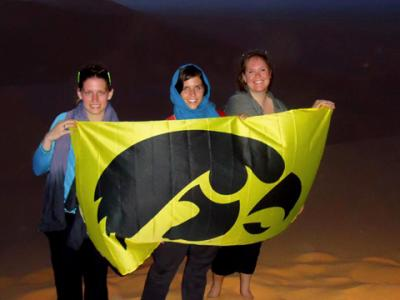Melanie Martin (right) holds an Iowa flag in Morocco as part of a study abroad experience