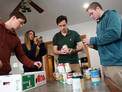 students sorting canned goods