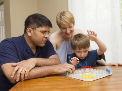 Cheeni Rao spends time with his wife and son, playing a game while sitting at a table