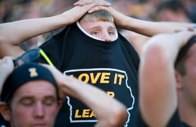 A fan tries to hide in his shirt
