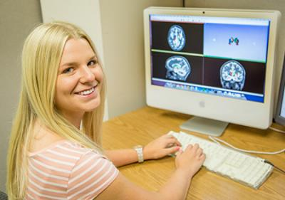 UI senior, Jolene Luther, is spending her 2013 summer in a fellowship position in hopes her contributions will help determine if iron deposits can be detected on MRI scans of Huntington disease (HD) research participants. Her grandfather died of HD in the