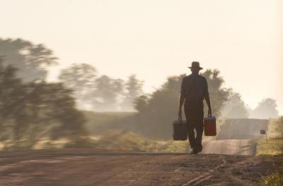 Amish man walking on a dirt road