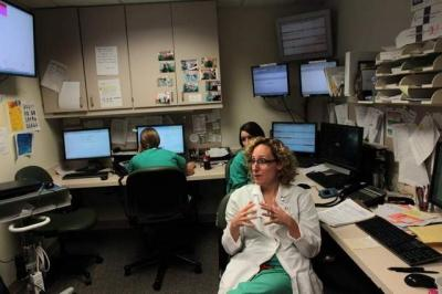 Rachel Maassen, a physician in the obstetrics and gynecology unit at University of Iowa Hospitals and Clinics, on Tuesday explains the constraints of small workrooms, particularly when filled with numerous employees. The Iowa state Board of Regents recent