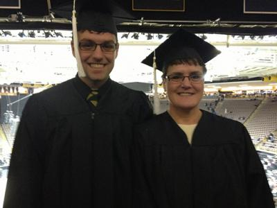 Photo of Leesa Fair and her son, Ben at Carver-Hawkeye Arena for December 2012 graduation
