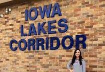 UI graduate Libby Glaser stands outside of the Iowa Lakes Corridor