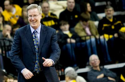 Fran McCaffery smiles on the sideline in Carver-Hawkeye Arena.