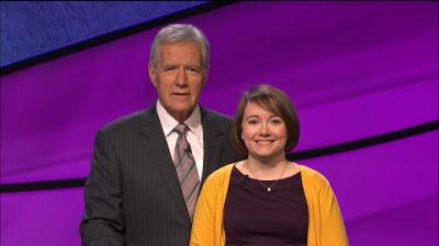 Jeopardy! champion Sarah McNitt, pictured with host Alex Trebek, returns Thursday for the Tournament of Champions semi-finals. Photo courtesy of Jeopardy!