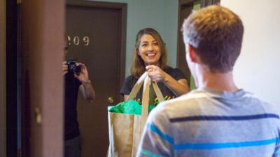 Leslie O'Hare of Your Campus Mom acts out her grocery delivery service with actor Kyle Walther, a University of Iowa graduate student, during the filming of a commercial for her business last week in Iowa City