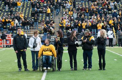 Mom and Dad of the Year presentation at Kinnick Stadium