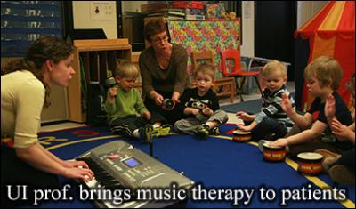 UI professor works with a group of young children using music therapy