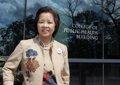 Visiting professor Naowarut Charoenca studies tobacco use and control in her home country of Thailand. Photo by Paul Curry.