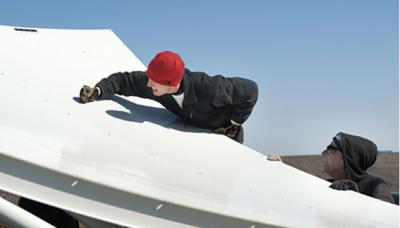 Photo of a student working on a NASA shuttle wing