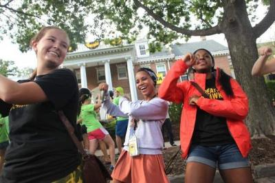 UI students bust a move in front of UI President Sally Mason's residence during the President's Block Party as part of On Iowa! activities.