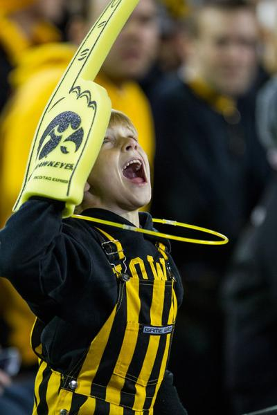 Cheering kid wearing a foam finger