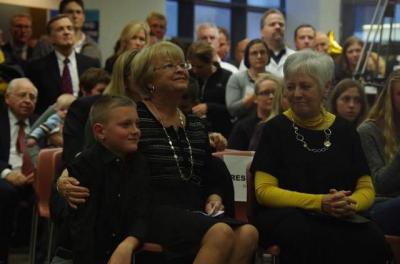 Ann Gerdin, middle, her grandson and University of Iowa President Sally Mason, right, attend the celebration of the Gerdin family's $12 million donation to the UI Children's Hospital's building campaign. / P-C file photo