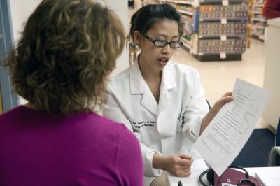 A University of Iowa College of Pharmacy student helps someone with information