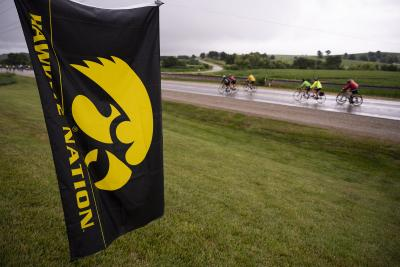 riders behind tigerhawk flag