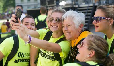 Sally Mason takes a selfie with students