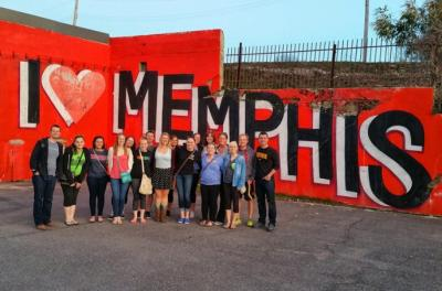 "A group of students stand in front of an ""I Love Memphis"" sign."