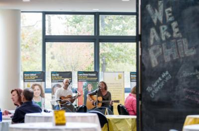Marc and Brandi Janssen, well-loved Iowa roots musicians, entertained faculty and staff during a We Are Phil lunchtime gathering in the College of Public Health. Brandi is a faculty member in the college and director of Iowa's Center for Agricultural S