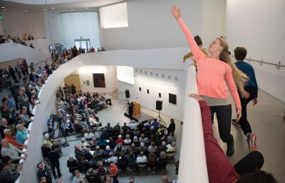 woman reaching skyward at visual arts building grand opening
