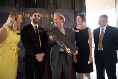 President Bruce Harreld receives the UI Presidential Medallion
