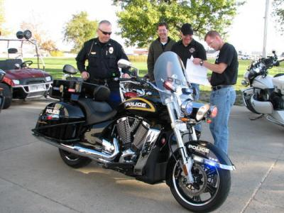 Photo by Russ Mitchell/ Members of the University of Iowa's Police Division pick up a pair of Victory Motorcycles customized for law enforcement at a Spirit Lake factory.
