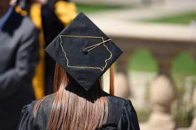graduate with state of iowa drawn on cap