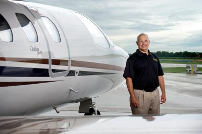 Dean Clay next to airplane