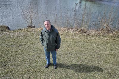 man standing near waterway
