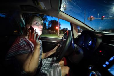 woman driving while talking on phone
