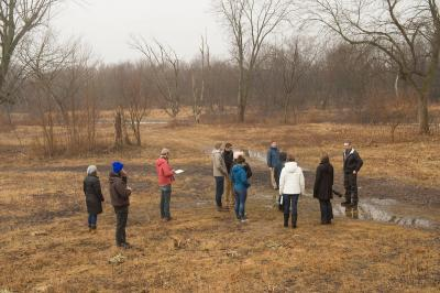 University of Iowa Environmental Management and Policy students tour an underused and flood-prone section of Terry Trueblood Recreation Area in south Iowa City