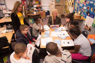 University of Iowa College of Education student working with students at a local elementary school