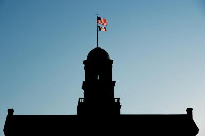 old capitol silhouette with flags visible