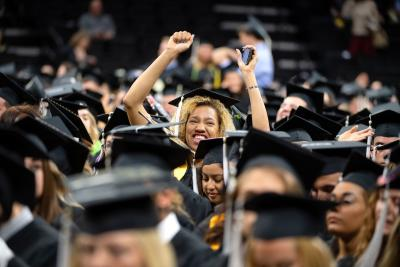 University of Iowa graduate celebrating at commencement ceremony
