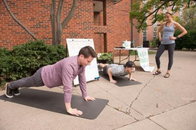university of iowa students doing pushups during Exercise Is Medicine challenge