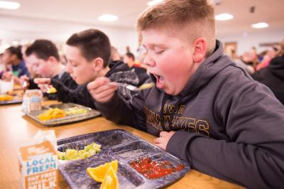 student eating in a lunchroom